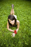 Woman relaxing on green grass Stock Photo