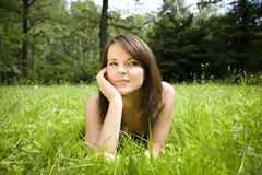 Woman relaxing in green meadow Stock Photography