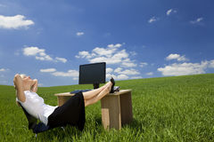 Woman Relaxing In a Green Office royalty free stock photography