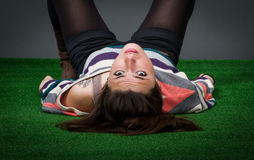 Woman relaxing in a green park Royalty Free Stock Photography