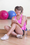 Woman relaxing after gym workout Royalty Free Stock Photography