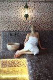 Woman relaxing in hammam Stock Images