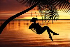 Woman relaxing in a hammock. On tropical background vector illustration