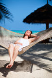 Woman relaxing in hammock Stock Image