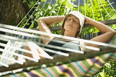 Woman relaxing in hammock. Stock Images