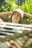 Woman relaxing in hammock. Royalty Free Stock Image