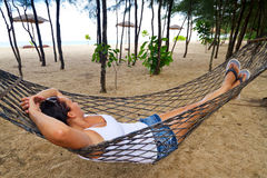 Woman relaxing on the hammock Royalty Free Stock Images