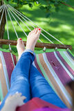 Woman relaxing on a hammock Stock Image