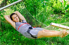 Woman relaxing in a hammock Stock Images