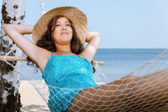 Woman relaxing on hammock at the beach Stock Images