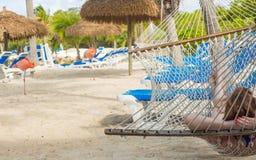 Woman relaxing in a hammock in flamingo beach Stock Photo