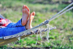 Woman relaxing in hammock Stock Images