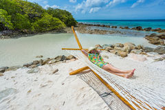 Woman relaxing in a hammock Royalty Free Stock Photos