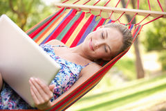 Woman Relaxing In Hammock With Laptop Stock Photography