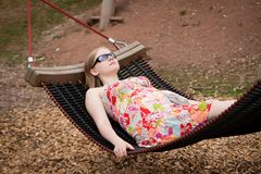 Woman relaxing in hammock in park Royalty Free Stock Photos