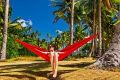 Relaxing in the hammock. Woman relaxing in hammock on Pinagbuyutan island, near Palawan, Phillipines Stock Photography