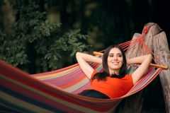 Woman Relaxing in Hammock on Summer Vacation. Happy tourist clearing her mind on relaxing holiday stock image