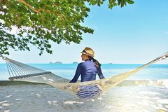 Woman relaxing in the hammock on tropical beach. Samui island Thailand Stock Image