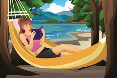 Woman Relaxing on a Hammock Stock Photo