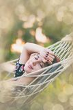 Woman relaxing in a hammock Royalty Free Stock Photography