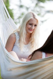 Woman relaxing in hammock Stock Photography
