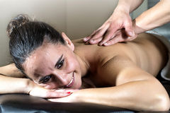 Woman relaxing with hand massage at beauty spa Stock Image