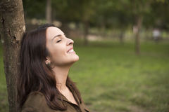 Woman relaxing. Woman with happy expression relaxing on meadow Stock Photography