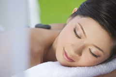 Woman Relaxing Having Hot Stone Treatment Massage Royalty Free Stock Images