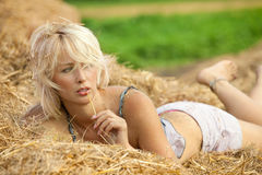Woman relaxing in hay stack Royalty Free Stock Images