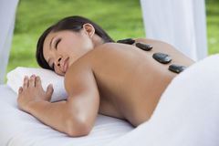 Woman Relaxing Health Spa Hot Stone Massage Royalty Free Stock Images