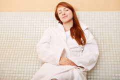 Woman relaxing on heated bench Royalty Free Stock Images