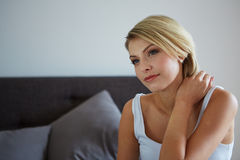 Woman relaxing on her bed Royalty Free Stock Photography