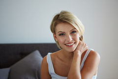 Woman relaxing on her bed Stock Photo