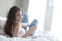 Woman relaxing on her bedroom Stock Photography