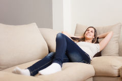 Woman relaxing on her couch Royalty Free Stock Photos
