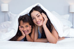 Woman relaxing with her daughter Royalty Free Stock Photos