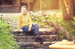 Woman relaxing in her garden Royalty Free Stock Photo