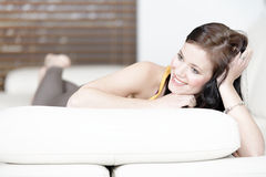 Woman relaxing on her sofa Royalty Free Stock Photography