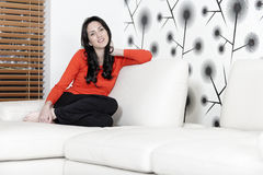 Woman relaxing on her sofa Royalty Free Stock Photos