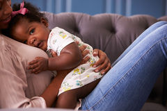 Woman relaxing with her toddler daughter, mid-section crop Stock Image