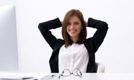 Woman relaxing at her workplace Royalty Free Stock Photos