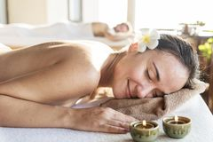 Woman relaxing with a herbal massage royalty free stock photography