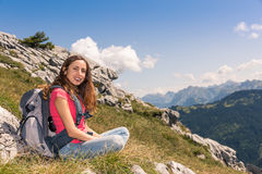 Woman relaxing during hike on mountains Royalty Free Stock Images