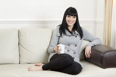Woman relaxing at home Royalty Free Stock Photos