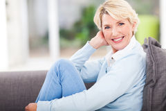 Woman relaxing home. Attractive middle aged woman relaxing at home Royalty Free Stock Photos