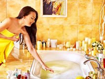 Woman relaxing at home bath. Stock Photos