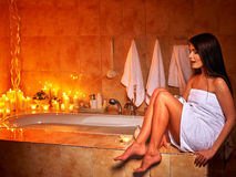 Woman relaxing at home bath. Woman relaxing at home luxury bath. Burning candle Royalty Free Stock Photo