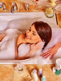 Woman relaxing at home bath Royalty Free Stock Image