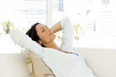 Beautiful happy woman relaxing at home - close up portrait stock photography