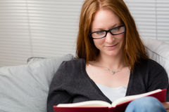Woman Relaxing at Home with a Book Stock Image